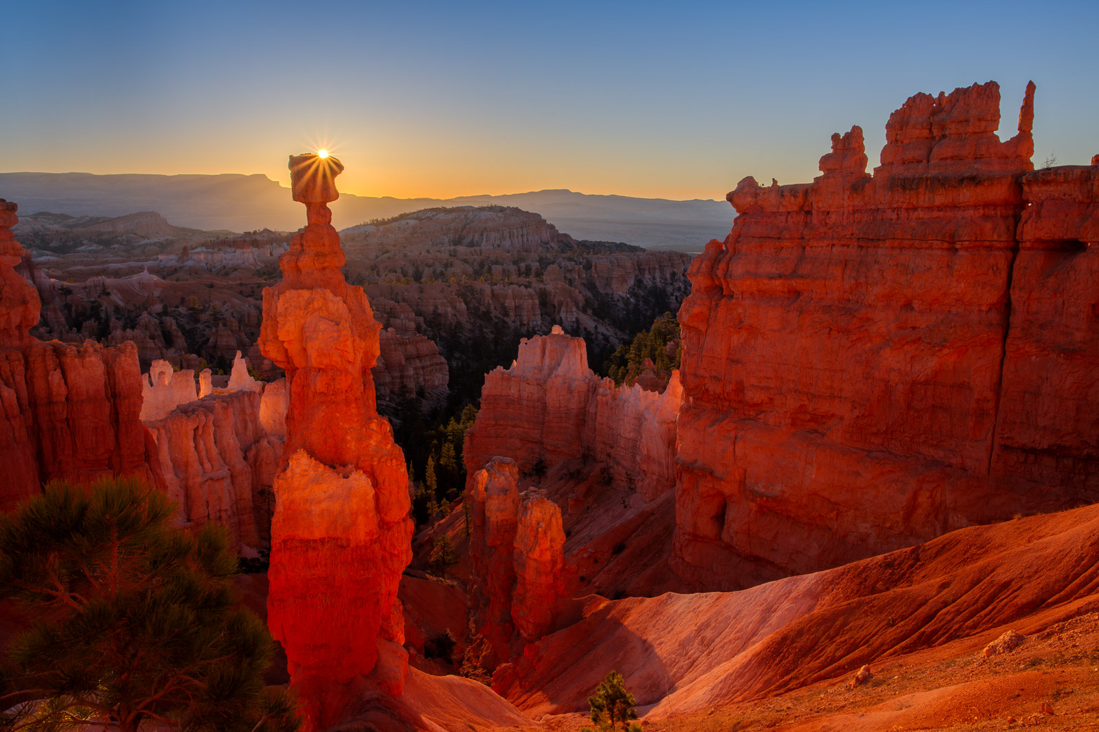 A Limited Edition, Fine Art photograph of Thor's Hammer at Bryce Canyon with the sun bursting from behind Thor's Hammer at sunrise...