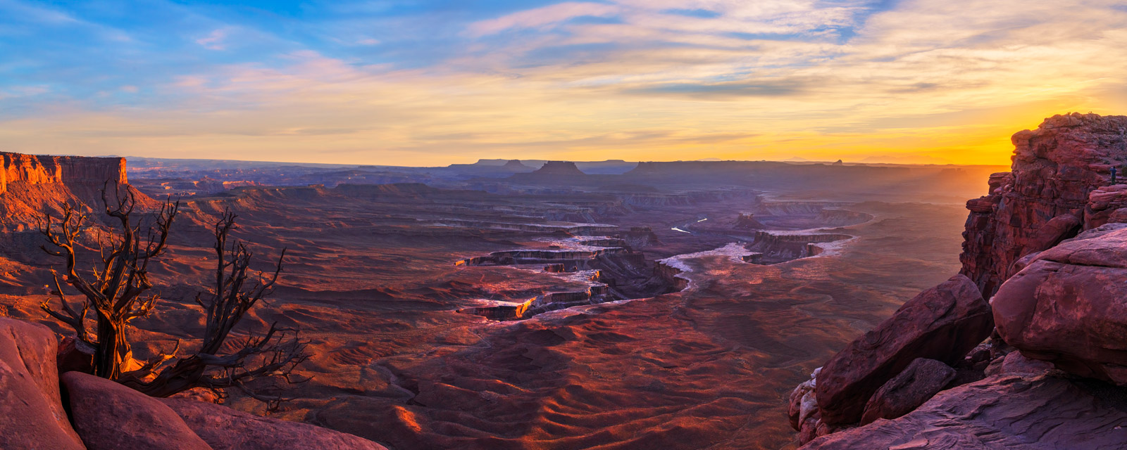 A Limited Edition Fine Art photograph from the Green River Overlook in Canyonlands National Park with the sun setting and lighting...