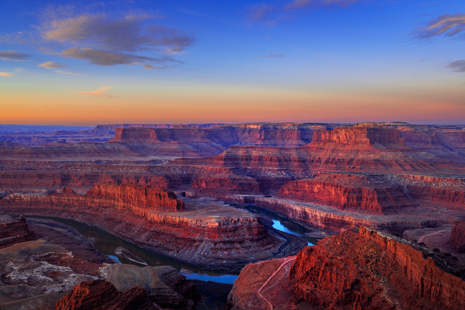 A Limited Edition, Fine Art photograph of Dead Horse Point State Park with the light of sunrise lighting up the red rock canyons...