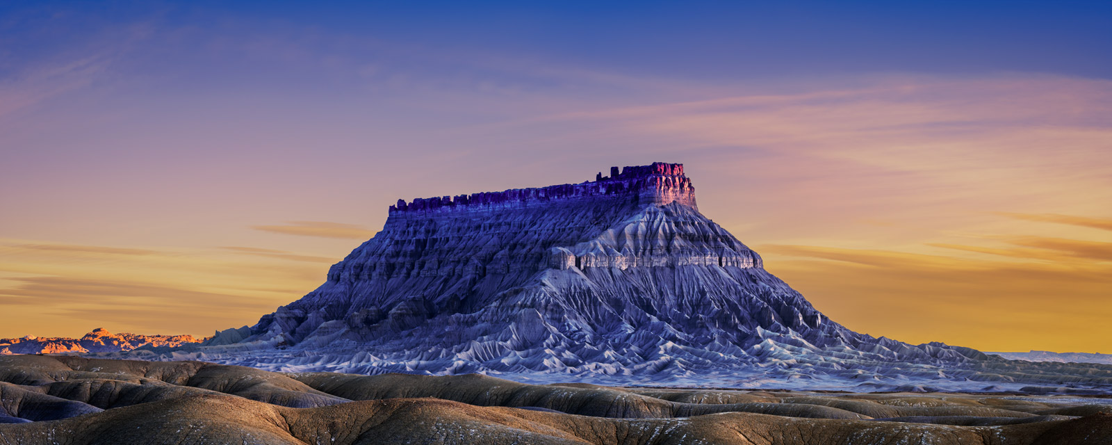 A Limited Edition, Fine Art photograph of Factory Butte at sunrise in a remote canyon in the Desert Southwest in Utah. Available...