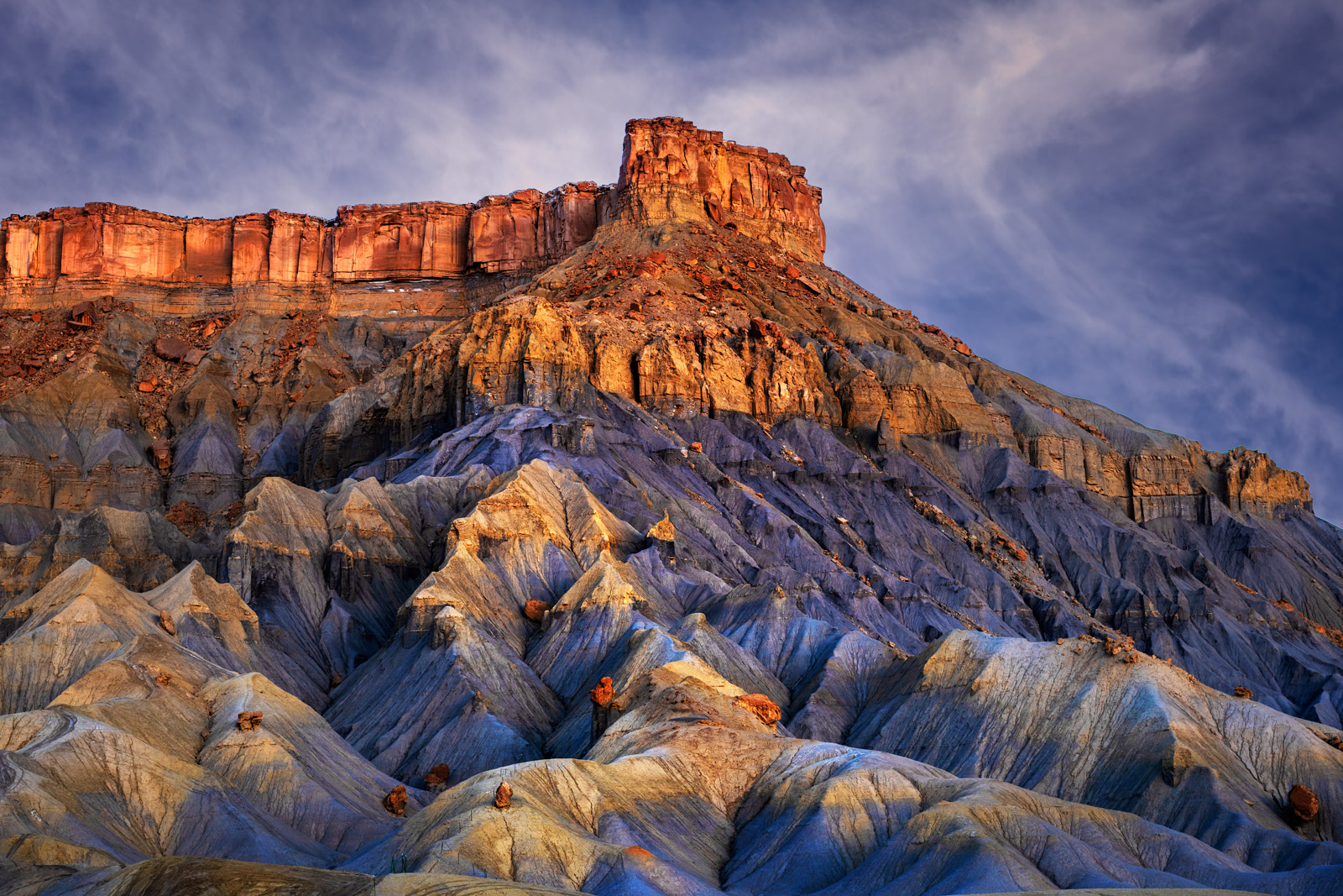 A Limited Edition, Fine Art photograph of sunrise light on a remote desert butte in the Desert Southwest in Utah. Available as...