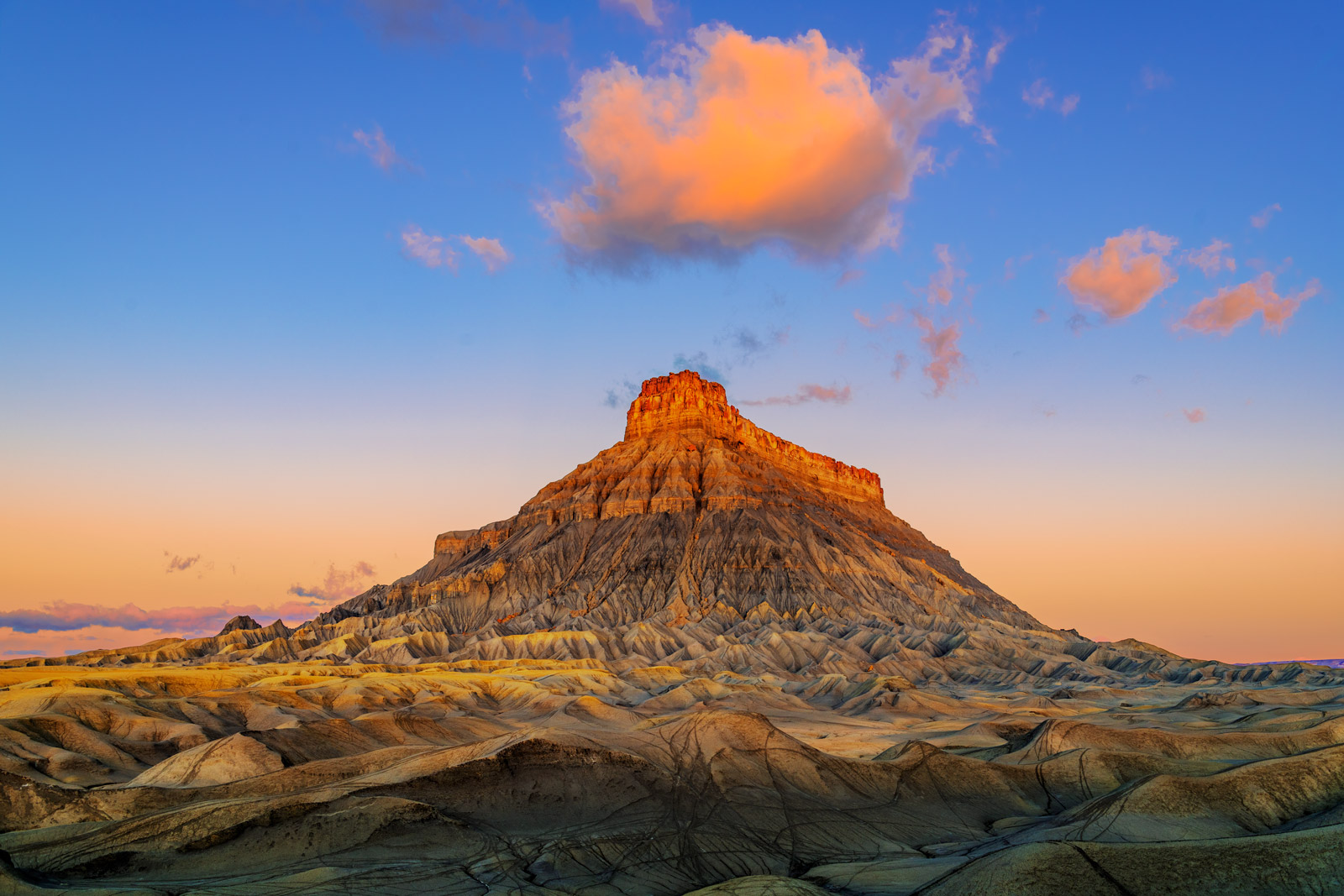 A Limited Edition, Fine Art photograph of Factory Butte receiving fresh sunrise light in a remote canyon in the Desert Southwest...