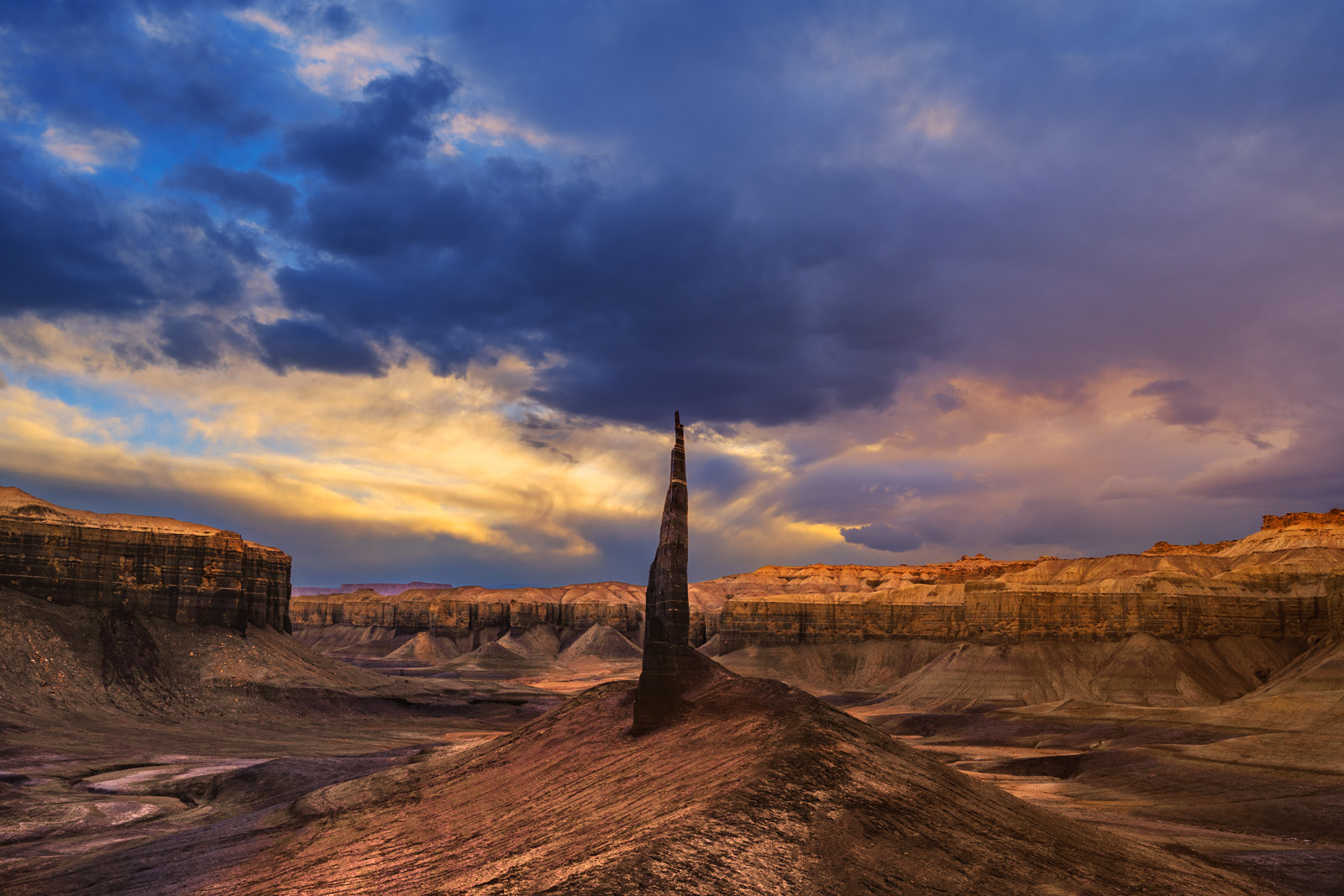 A Limited Edition, Fine Art photograph of a dramatic rock spire at sunset in a remote canyon in the Desert Southwest in Utah....