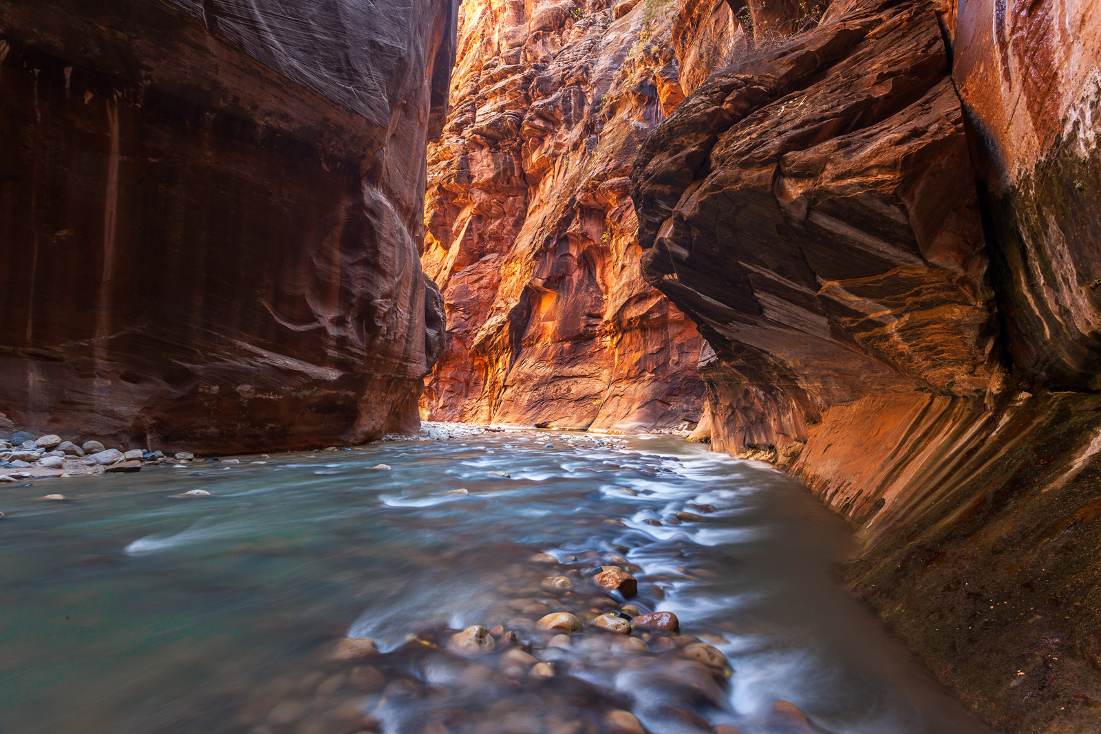 A Limited Edition, Fine Art photograph of The Narrows with overhanging rock walls on a bend in the Virgin River in Zion National...