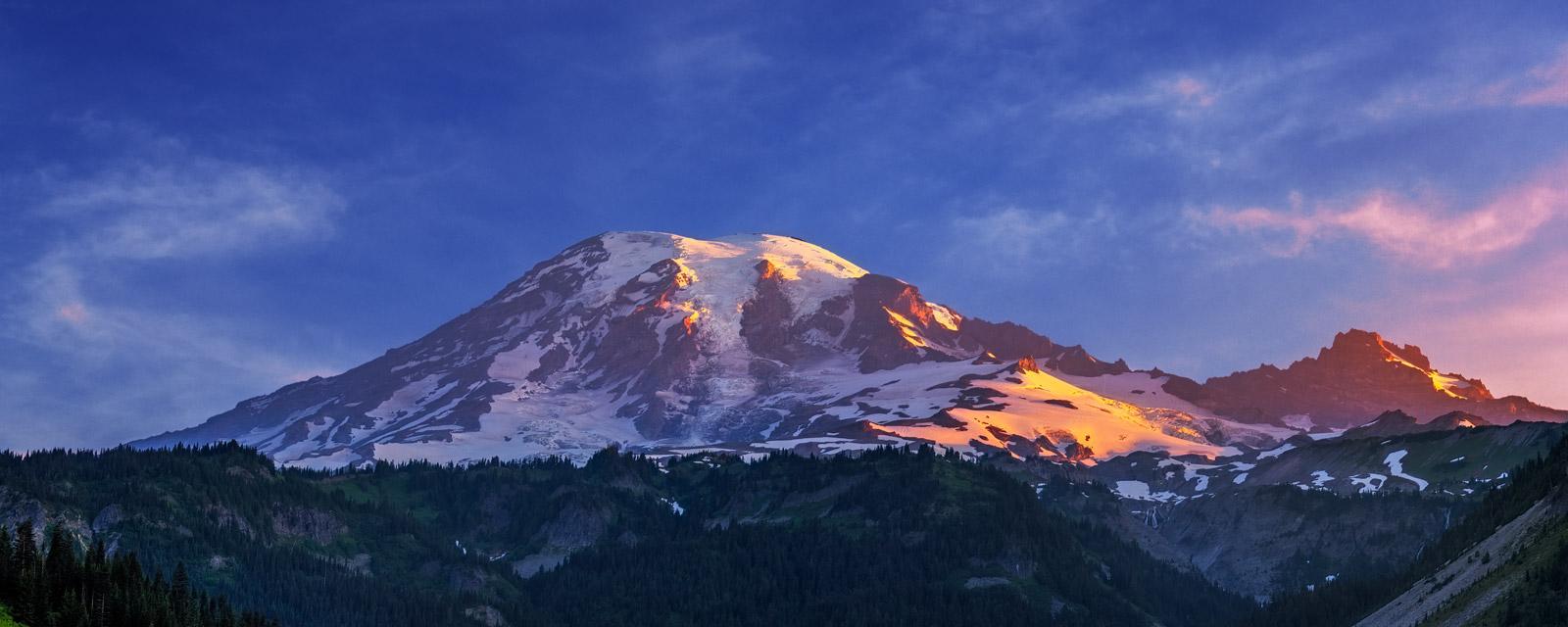 A Limited Edition, Fine Art panoramic photograph of sunrise light hitting Mount Rainier in Washington. Available as a Fine Art...
