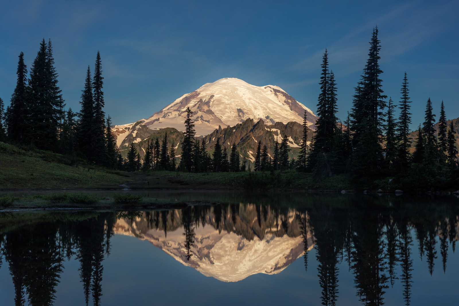 closeup reflection of mount rainer in little tipsoo lake