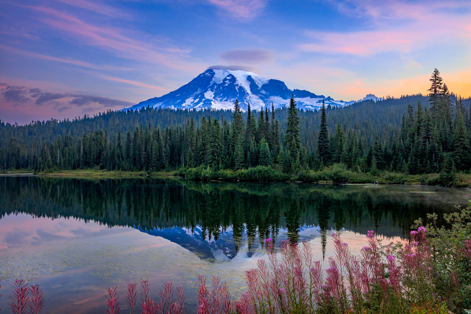 A Limited Edition, Fine Art photograph of Mount Rainier reflecting in Reflection Lakes with a foreground of flowers in Washington...