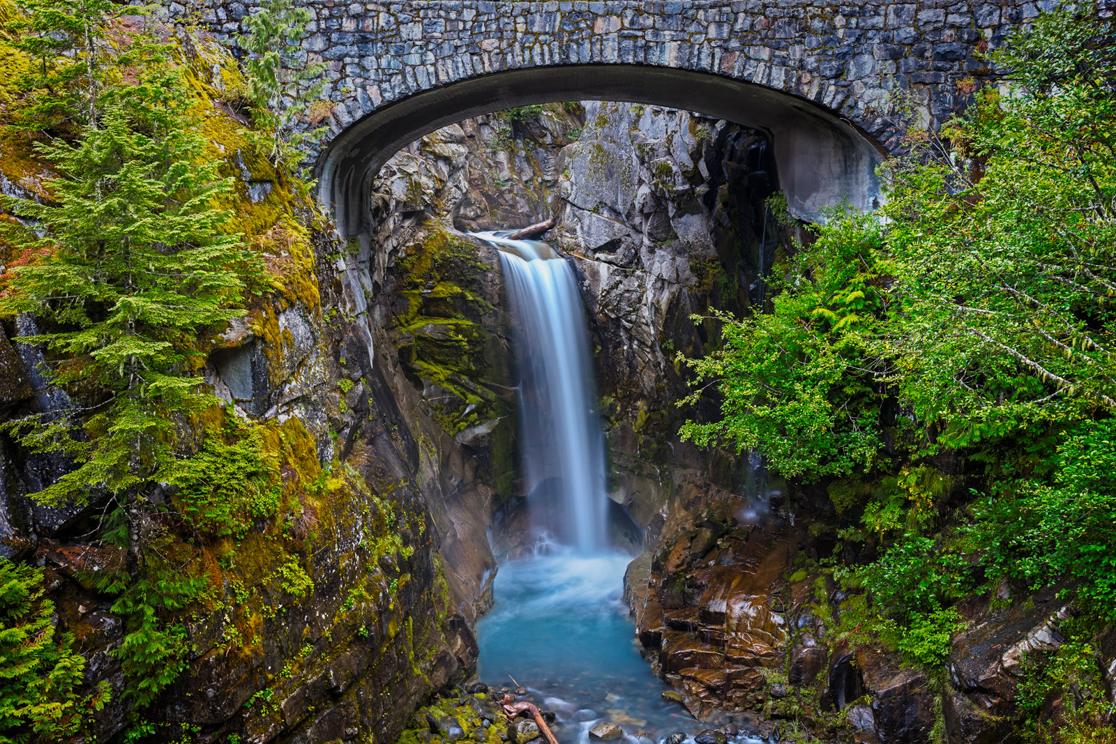 A Limited Edition, Fine Art photograph of the beautiful Christine Falls with a brick overpass and aqua river below at Mount Rainier...