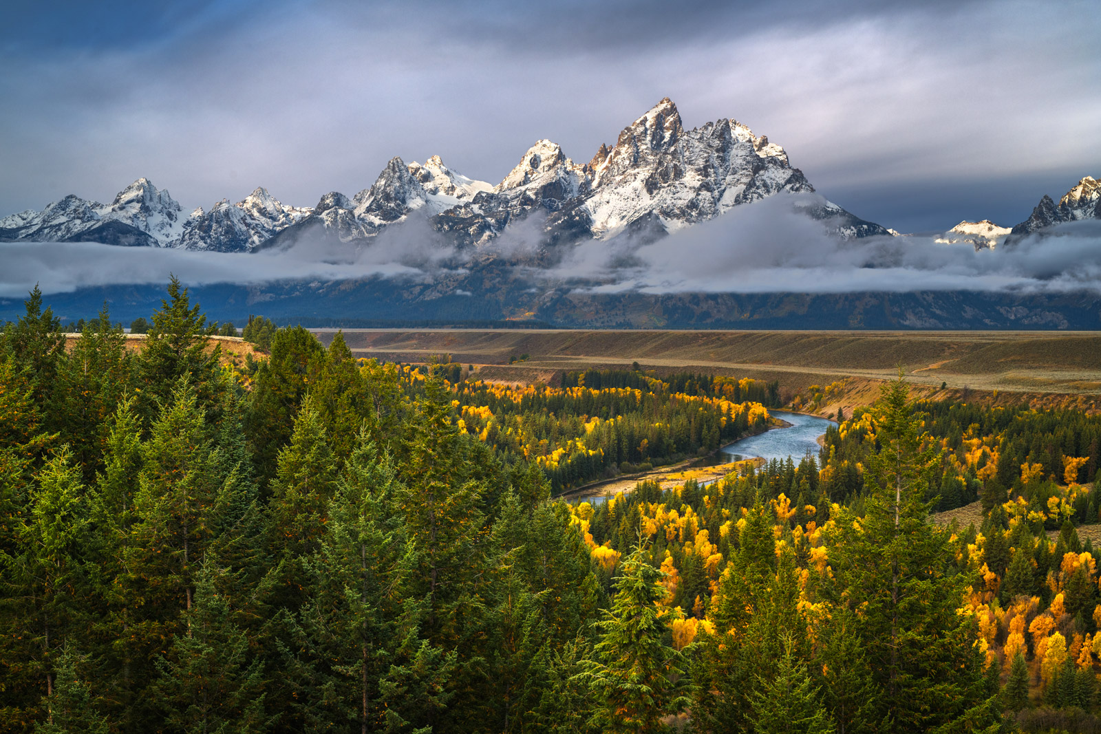 A Limited Edition, Fine Art photograph of the Snake River with beautiful fall colors beneath the mountains at Grand Teton National...