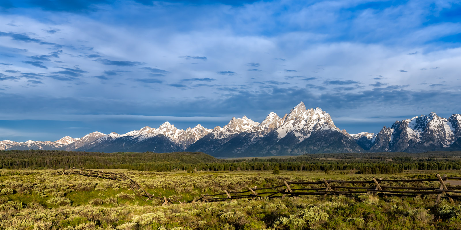 A Limited Edition, Fine Art photograph of the mountains outside an old western style fence at Grand Teton National Park in Wyoming...