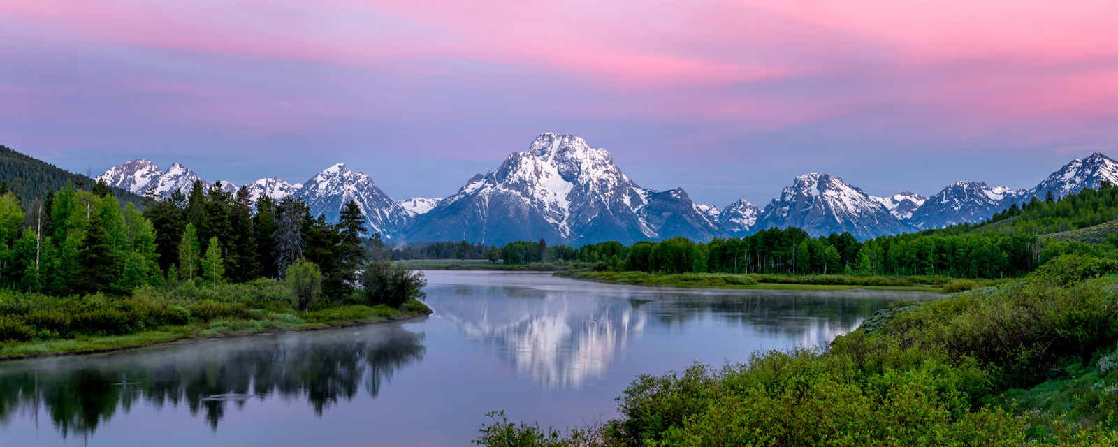 A Limited Edition, Fine Art photograph of Oxbow Bend with pink morning clouds and a snow capped Mount Moran reflecting in the...