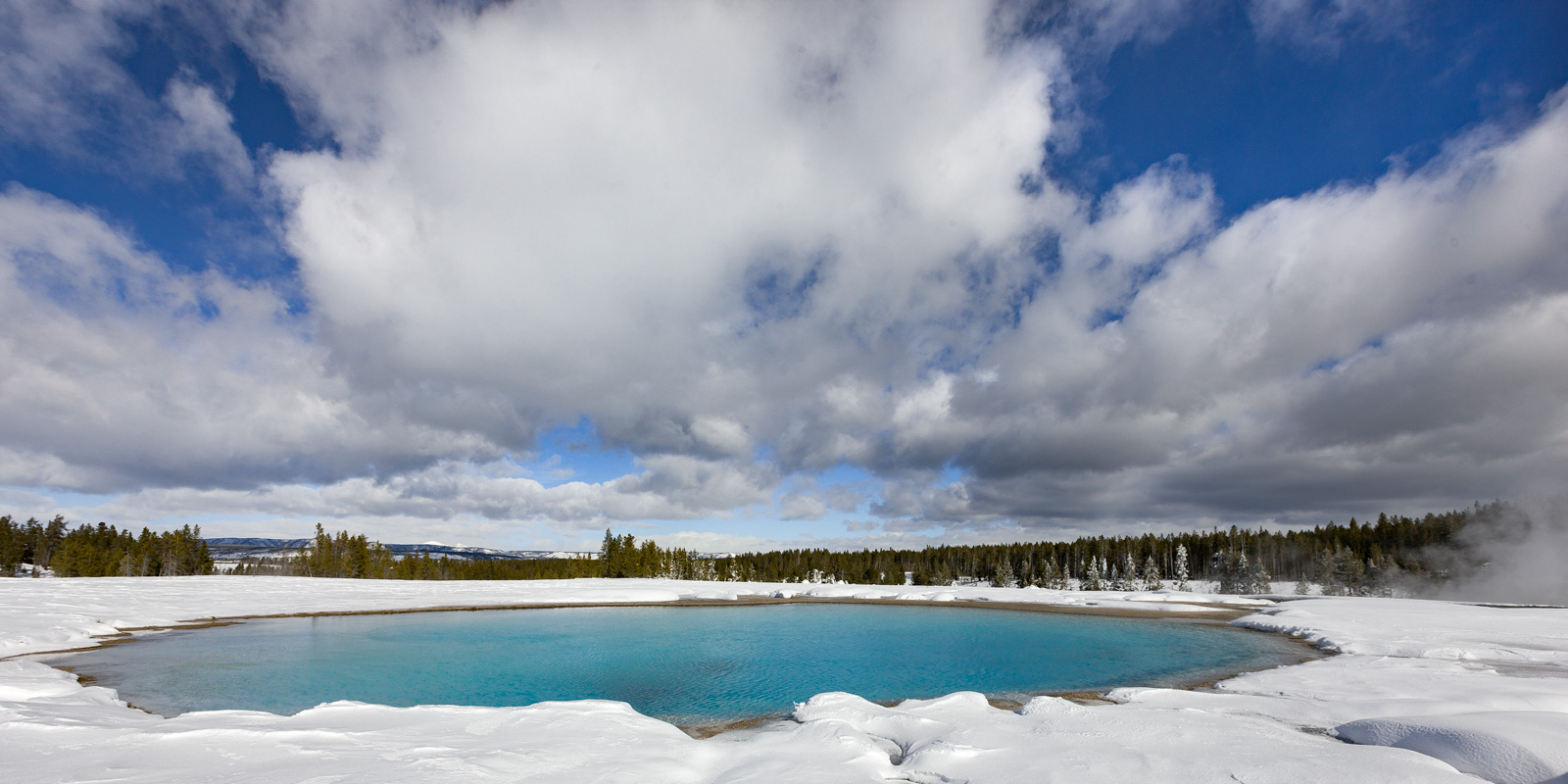 A Limited Edition, Fine Art photograph of deep snow surrounding a bright aqua spring next to Grand Prismatic Spring at Yellowstone...